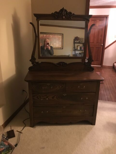1900's ANTIQUE OAK 4 DRAWER DRESSER with SWING MIRROR for sale onli
