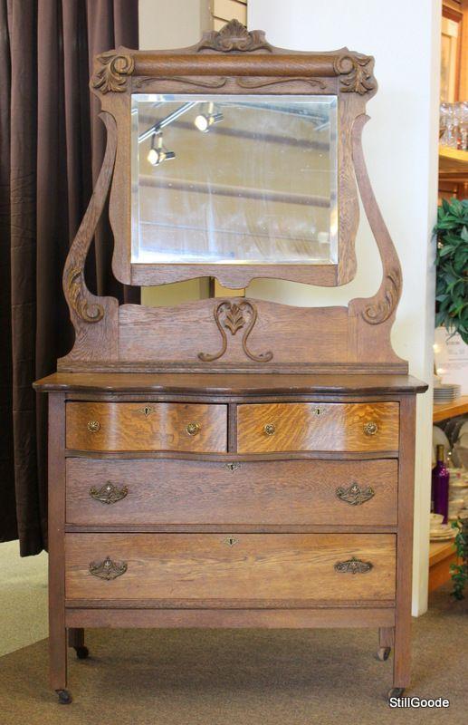 Vintage oak 4 drawer dresser with adjustable mirror .