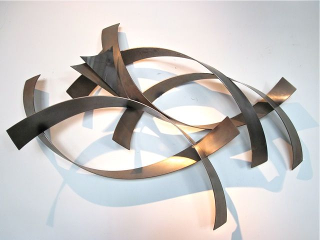 Get stylish designs of abstract metal wall sculptures to decorate .