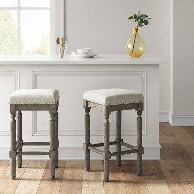 Erving Wood and Upholstered Backless Counter Stool Taupe .