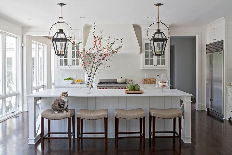 White Kitchen with Taupe Leather Counter Stools - Transitional .