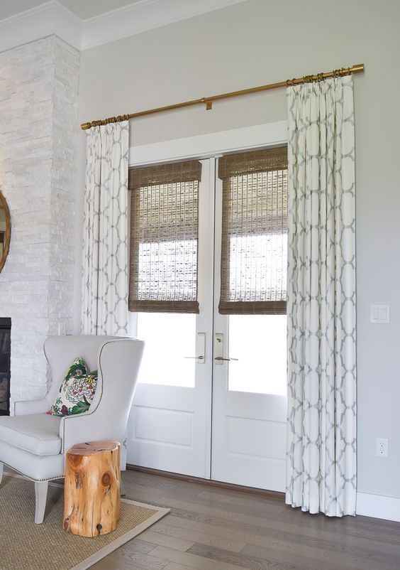 patterned curtains and bamboo shades for style and privacy .