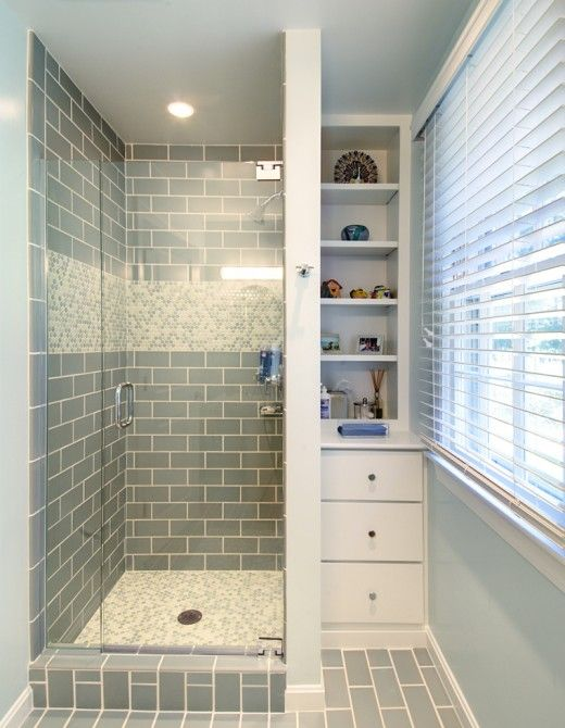 blue-gray subway tile + shower floor tile (not the stripe on the .