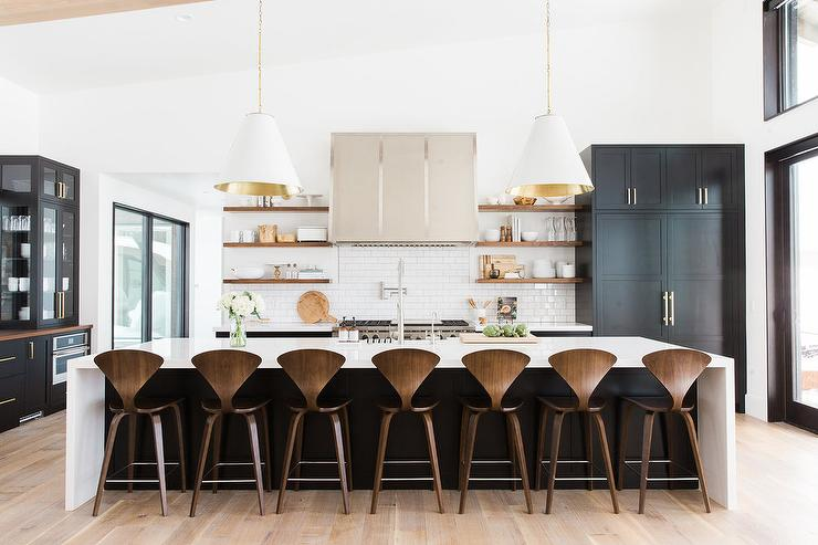 White and Black KItchen Island with Cherner Counter Stools .
