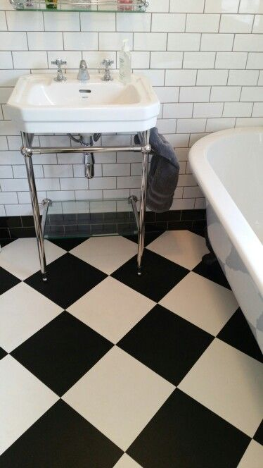 New bathroom. Black and white chequerboard vinyl floor tiles from .