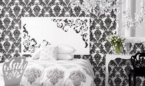 Calming the busy damask patterns on walls and bed cover with black .