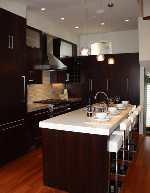 Modern Kitchen Espresso Cabinets, Carrara marble countertops .