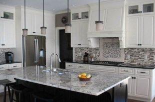 White ice granite countertops for a fantastic kitchen decor .