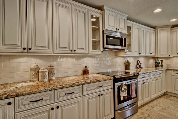Image result for white cabinets with Antique Mascarello counter .