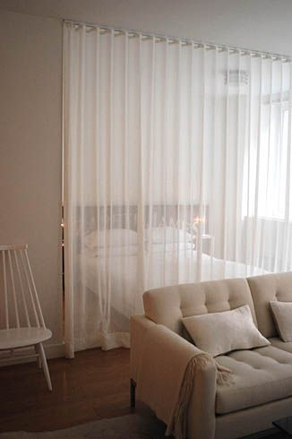 Strongly considering sheer curtains as dividers in the new space .