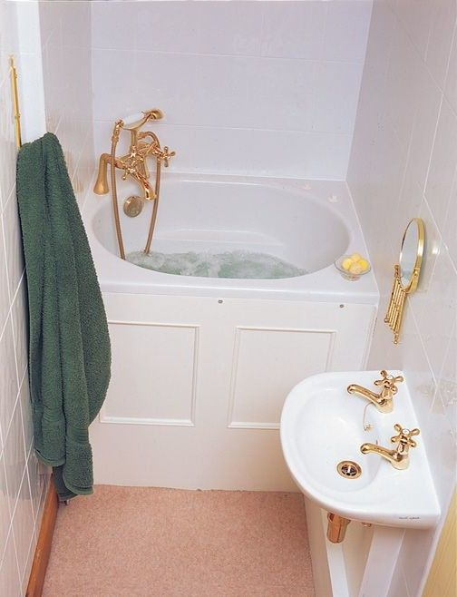 small bathroom idea with corner deep tub with gold-tone faucet .