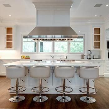 Island with white Leather Barrel Back Counter Stools, Transitional .
