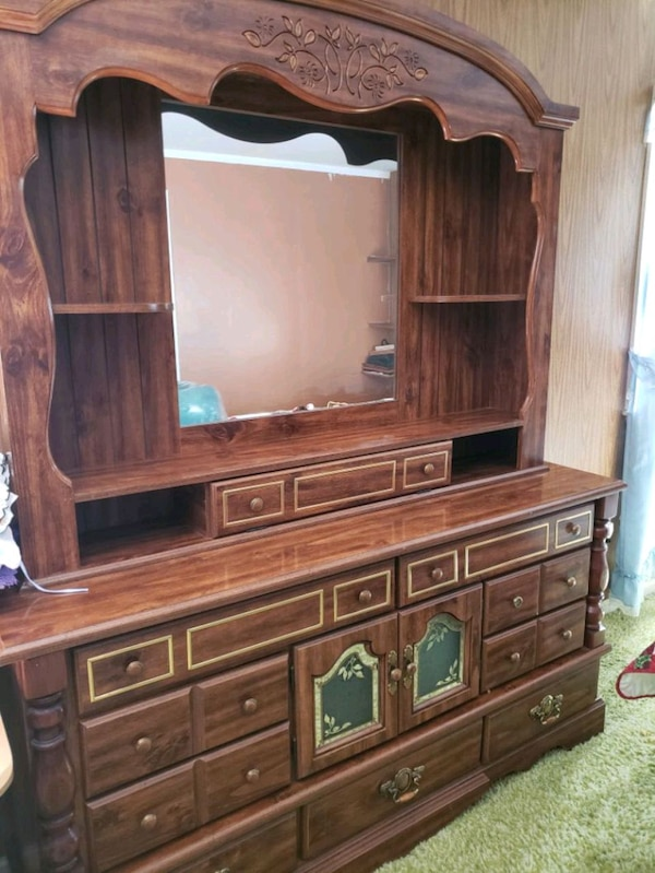 Sold 9 drawer dresser with mirror and side shelves. in Virginia .