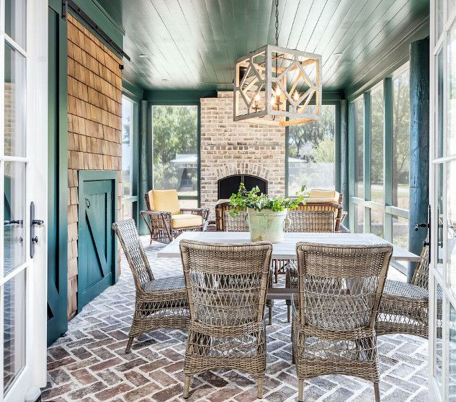 Herringbone brick flooring. Screened in patio with Herringbone .