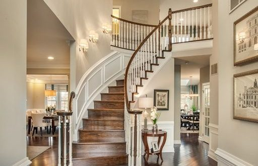 Traditional Entryway with Wainscoting, High ceiling, Chandelier .