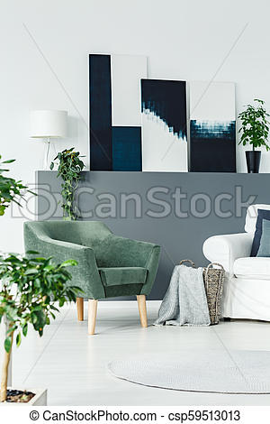 Green armchair in room. Green armchair standing in white living .