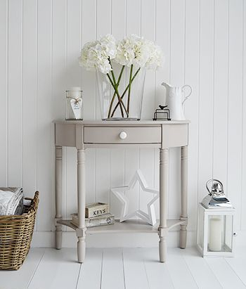 The Oxford grey half moon console table with drawer and shelf .