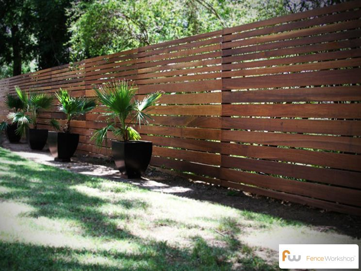 Horizontal board fence design. This fence was made from ironwood .