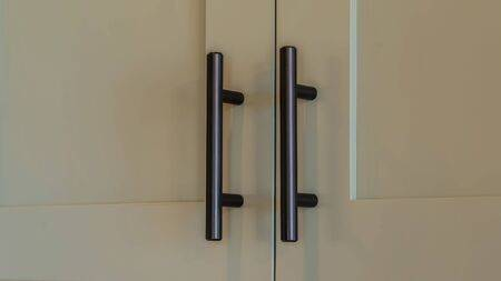 Panorama Close Up Of Overhead Kitchen Cupboard Handles. A Close .