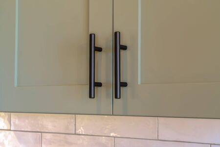 Close Up Of Overhead Kitchen Cupboard Handles Stock Photo, Picture .