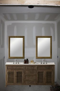 One large mirror or two individual mirrors over double vanity .
