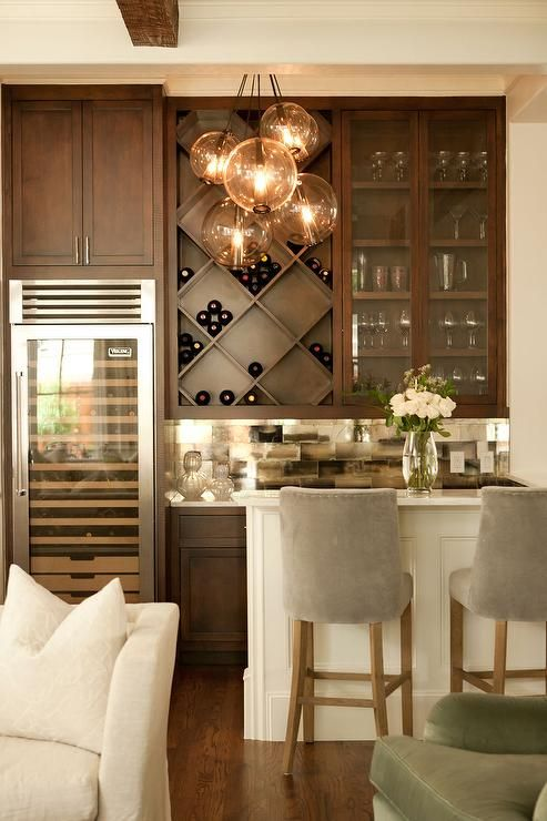 Chic living room bar features dark stained shaker cabinets paired .