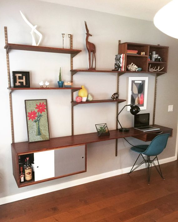 This Mid Century Modern style Walnut Wall Shelving Unit can be .