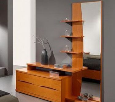 Layered dresser design, with a tall mirror sided with shelves and .