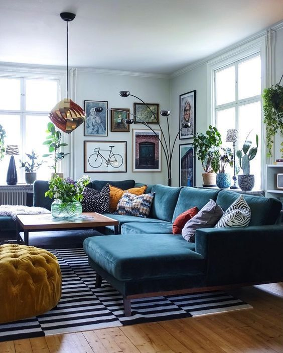 A graphic black and white striped rug grounds the seating area in .
