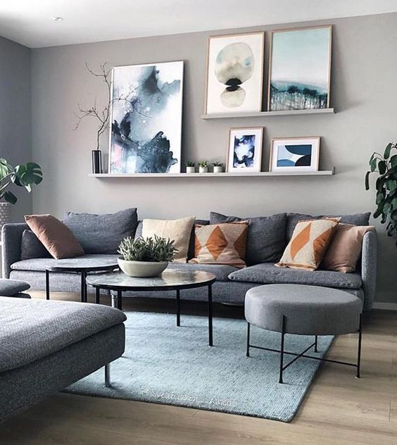 Modern living room, wall art, grey couch, Scandinavian design .