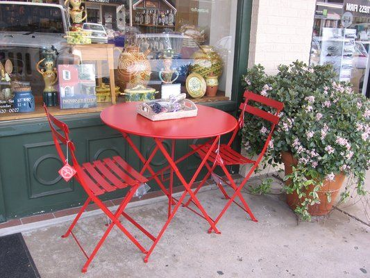 I adore this little poppy red bistro table ~ made in Franc