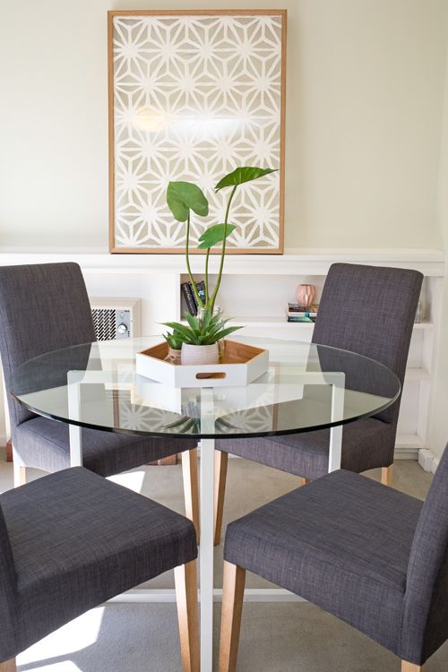 Small dining area, small apartment, round glass top dining table .