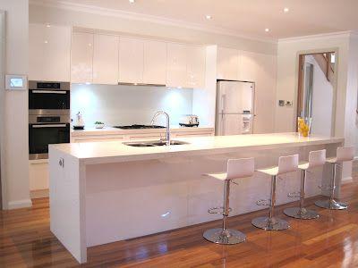 White modern kitchen, breakfast bar, island, stools, glass .