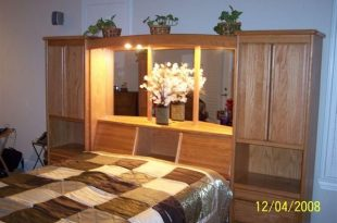 Headboard with Storage and Lights to read at night. Awesome. Oak .