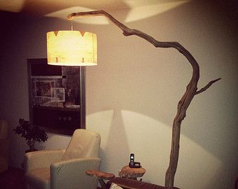 Unique floor lamp / Arc Lamp. made of oak branch, on natural stone .