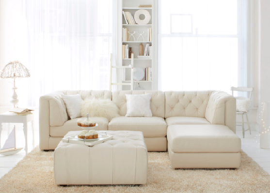 An all-white palette can make a small room seem a whole lot larger .