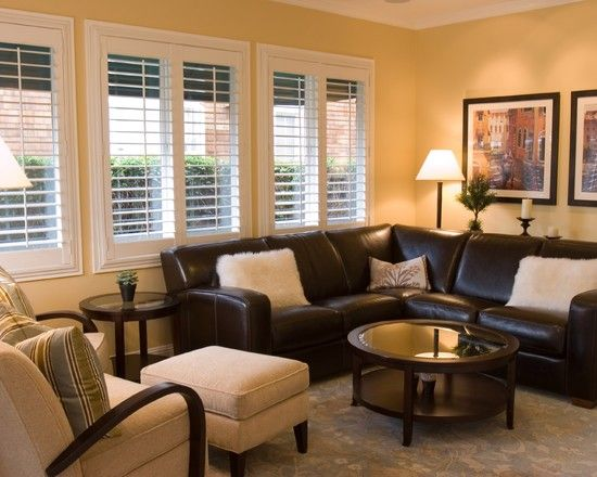 Family Room Dark Brown Leather Sectional with yellow walls and .