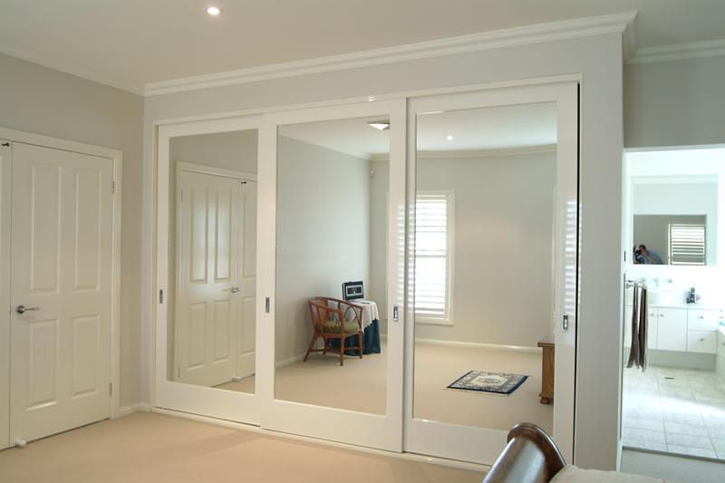 Hanging sliding wardrobe doors can possess a mirror | Interior .