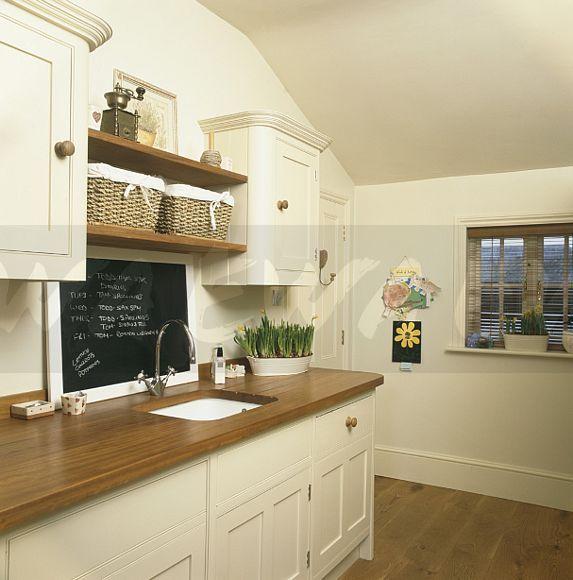 cream and oak kitchen ideas | Image: Blackboard above sink in .
