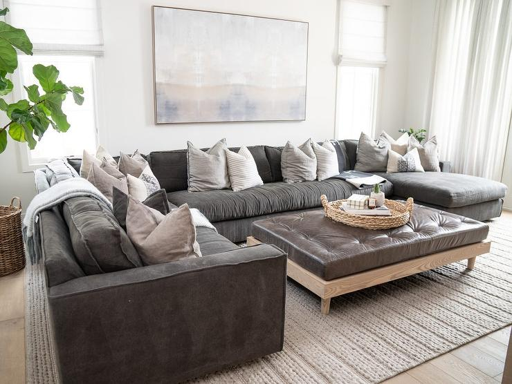 Black Leather Sectional with Brown Leather Tufted Ottoman Coffee .