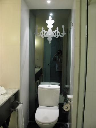 chandelier mirror in toilet. ~witty~ - Picture of The Luxe Manor .
