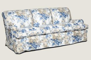 A large three seat sofa in a traditional style upholstered in a .