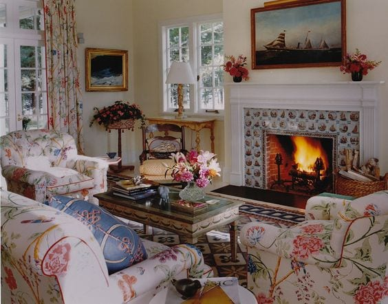 delft-tile-fireplace-chintz-sofa-chairs-sea-art - The Glam P