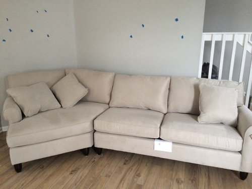 My linen couch looks beige and clashes with my wall