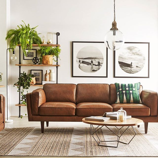 Tan leather sofa with pendant light | Leather couches living room .