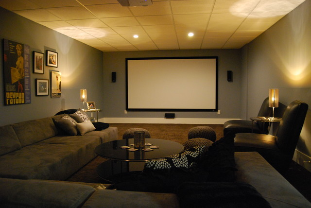 Basement media room with sectional sofa and giraffe texture .