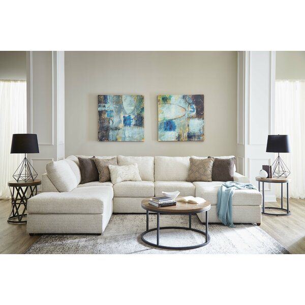 This sectional has chic sophistication with the low profile arm .