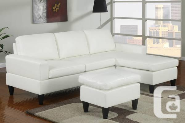 BRAND NEW, Leather Sectional Sofa, FREE Ottoman + FREE Delivery .