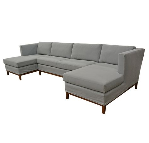Large Quatrine slipcovered chaise sectional with wood base .