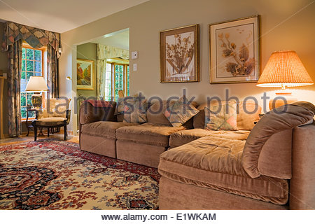 Living room with sectional sofas inside a residential home Stock .